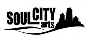 Black letters against white background read Soul City Arts. On the right, a city skyline in black.